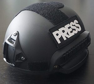 helmet with press badge