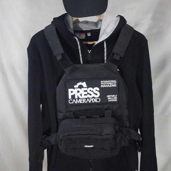 Press velcro on the black vest
